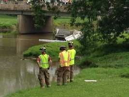 Crews placed booms in the water to contain the leakage.