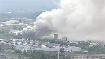 A huge fire at a Harrisburg recycling center pumps smoke into the air on Thursday morning.