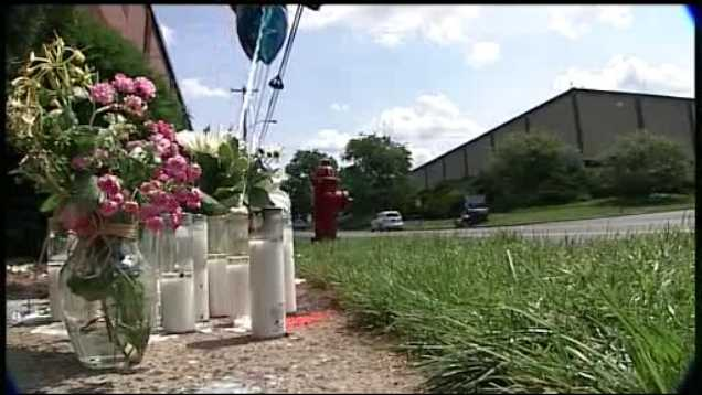 A memorial is setup in memory of Xavier E. Garriga along New Holland Avenue.