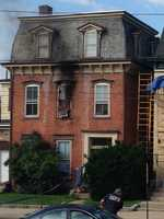 The fire happened at a three-story historic home that had been converted into six apartments on the 100 block of North Third Street.