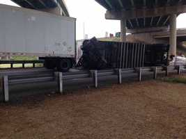 A tractor-trailer flipped onto its side Wednesday morning at a busy Susquehanna Valley interchange.