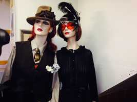 Through the storefront windows, passersby can see mannequins dressed up in elaborate clothes.