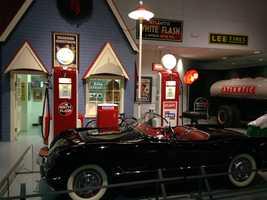 Many of the displays feature old automotive signs and gas pumps.