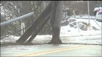 A tractor trailer hit a utility pole, knocking down the pole and some and wires.