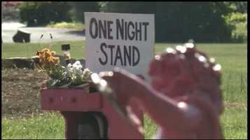"The eccentric display includes statues, scantily-clad mannequins and a pink-colored night stand with a sign that reads ""One Night Stand."""