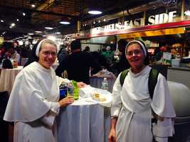 """Sister Mary Michael and Sister Maria Teresita of Nashville, Tennessee, enjoyed Philly pretzels this weekend. They also stopped by Rosa's Fresh Pizza at 11th and Chestnut, where there is a """"pay it forward"""" deal. The shop allows people to buy a slice of pizza for a homeless person - and both sisters did just that."""