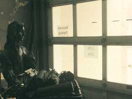 A statue, used for OperaLancaster productions, faces the windows inside the firehouse.