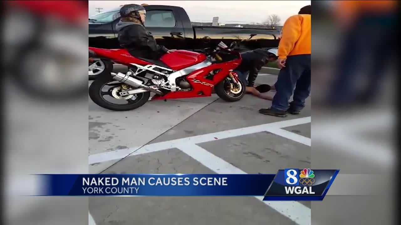 VIDEO: Naked man causing scene is subdued by two private citizens