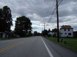 In Ohioville, a mile-long stretch of Kelly Road is reported to be the site of supernatural activity, including unexplained noises and white apparitions.