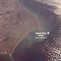 The Outer Banks of North Carolina from space showing the approximate position of the Monitor National Marine Sanctuary. This photo was taken by the Apollo 9 astronauts 3/12/69, during their 136th orbit of Earth.