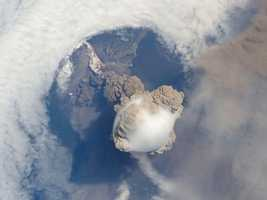 A fortuitous orbit of the International Space Station allowed the astronauts this striking view of Sarychev volcano (Russia's Kuril Islands) in an early stage of eruption on June 12, 2009. Sarychev Peak is one of the most active volcanoes in the Kuril Island chain and is located on the northwestern end of Matua Island. Prior to June 12, the last explosive eruption had occurred in 1989 with eruptions in 1986, 1976, 1954 and 1946 also producing lava flows.