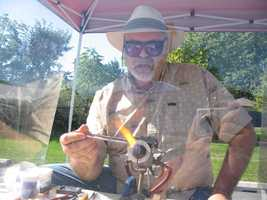 Chris Bryan, of The North Star of Lititz, works to make a pendant at the Lititz Farmers Market.