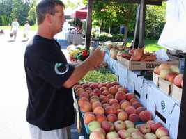 Jimmy Bauer, of Lititz, oversees the Charles Family Market Stand at the Lititz Farmers Market.