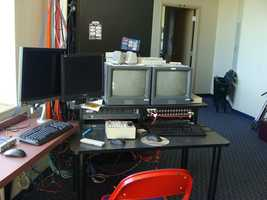The director has two computers: one that carries player stats and sponsor slides, and another that has fun stuff like videos and live cameras.