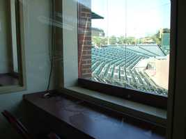 There are two radio booths, one of which is for the Voice of the Revolution, Darrell Henry. They have windows because outside Darrell's booth is where the official score keeper sits.