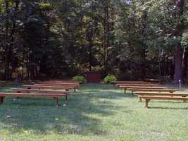 An outdoor area, located across from the playhouse, is used for church services.