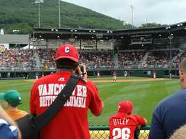 Fans behind the outfield fence watch the Panama/Canada game at Volunteer Stadium in 2010.