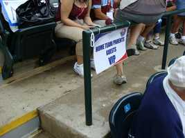 Parents and family of LLWS participants sit in the front rows above the dugouts.