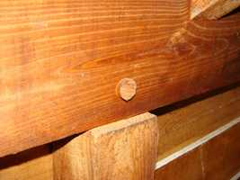 Another sign of the times -- wooden pegs were used in the attic to secure wood.