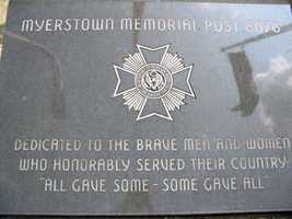 The marker outside the Myerstown VFW reflects the flags.