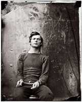 This veteran of the Battle of Gettysburg, Lewis Powell, shown here in shackles inside a U.S. warship, was one of four people hanged for the Lincoln assassination conspiracy.