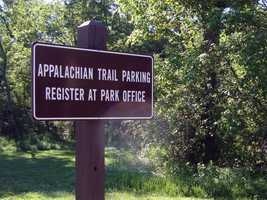 A gravel parking lot is available for trail users ...
