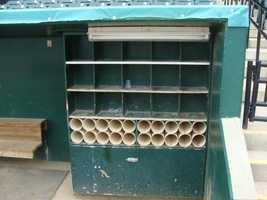 This is where players keep bats, gloves, and helmets in the dugout during games.