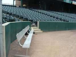 This is where the bullpen sits during games. Players are close to the stands and sometimes talk to fans during the game.