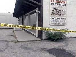 Charles Pohlman, of Hanover, was found dead in this toy train shop. His throat had been cut and he bled to death.