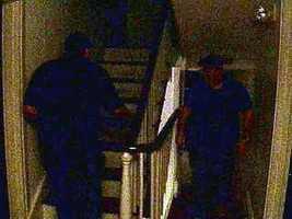 An investigator heads for an upper floor.