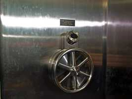 This is one of the wheels that opens the door. You turn the knobs on the sides to enter the combination. The other wheel unlocks the vault. It takes 15 seconds for the door to open.