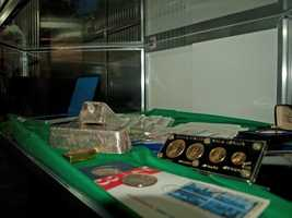 A display case in the vault of items that have been claimed but not picked up yet.