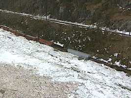 A 122-car freight train ground to a halt along the river when ice and water flowed over the banks, pinning it against a hillside.
