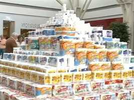 Students in Fayetteville spent their Sunday afternoon building a giant pyramid out of TP, but the fun and games are going to good causes.