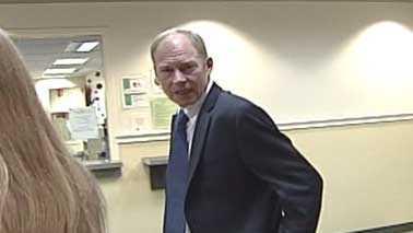 Curt Johnson leaving court