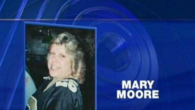 A search warrant reveals why Mary Moore may have been lying in the street the night she was killed.