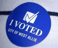 Voter stickers being handed out in West Allis.