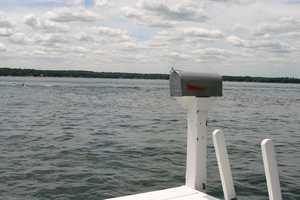 The objective: Get the mail (yes real USPS mail) off the boat, to the mail box, and back onto the moving boat.