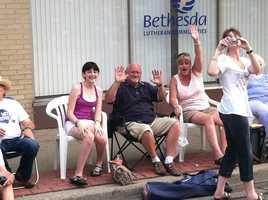 People waving at Toya and Jason