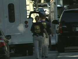 Agents from several agencies, including the FBI, are at the scene of a duplex on E. Holmes Ave. in Cudahy.