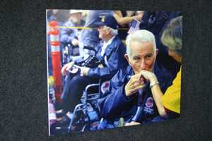 "A series of ""the best of"" photos from past Honor Flights were on display."