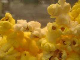 The popcorn has chemicals in it to make its aroma fill the theater.