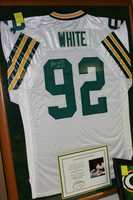 A Reggie White autographed jersey is available, comes with certificate of authenticity