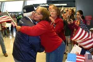 Hugs and handshakes from strangers are not uncommon at this welcome ceremony.