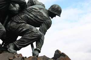 "Felix de Weldon's design was based on the iconic photo ""Raising the Flag on Iwo Jima"" by AP photographer Joe Rosenthal."