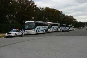 Buses lined up on Memorial Drive outside Arlington National Cemetery.