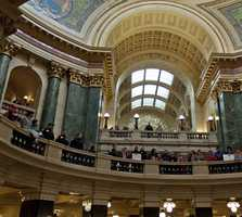 Protesters filled the Wisconsin Capitol in 2010 to protest the measure, which also removed collective bargaining rights for public employee unions.