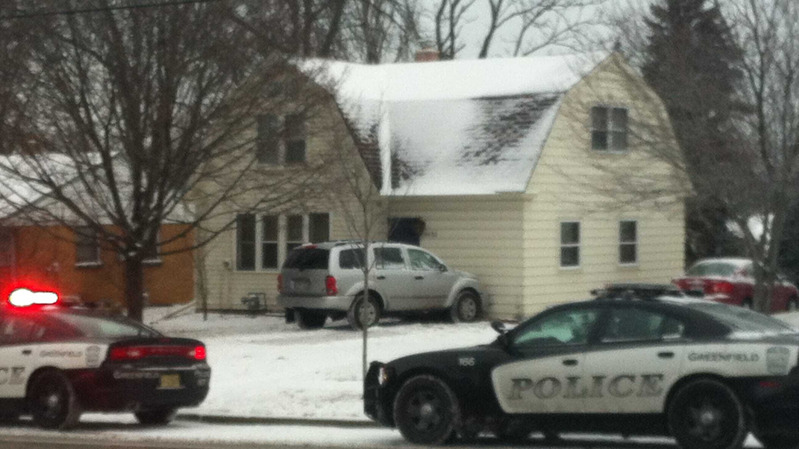 SUV into house