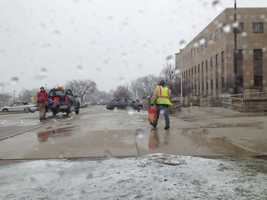 Waukesha County workers spread salt in front of the courthouse.