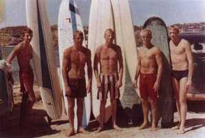 """""""Baggies"""" were boxer-style swim trunks that were preferred by surfers in the day. The extra fabric prevented surfboard wax from ripping out upper-leg hair when surfers slid to a standing position."""
